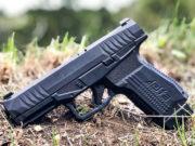 pistola striker fired Rex Delta