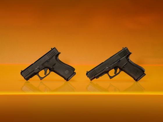 a fianco, le pistole g43x e g48 su fondo arancione