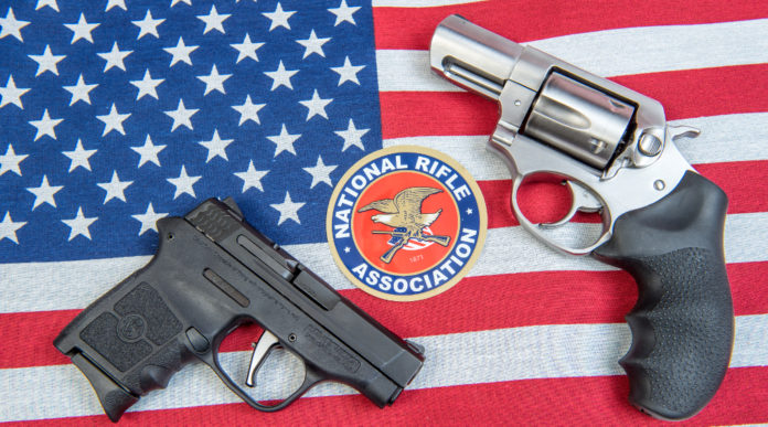 convention Nra: logo national rifle association tra due pistole