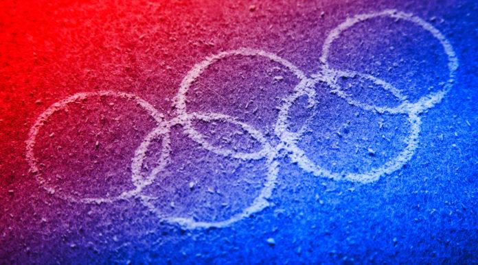 giochi olimpici: cinque cerchi su fondo rosso e blu